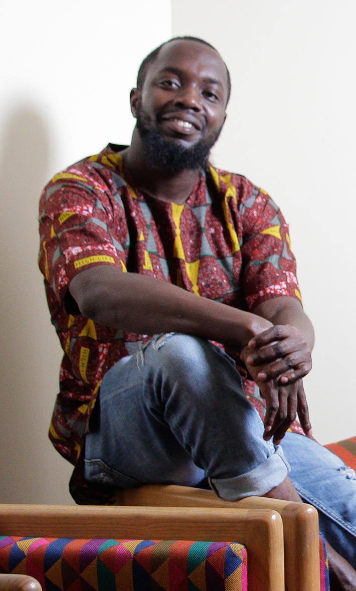 photograph of art student Emmanuel Oluwaseyi Bamtefa sitting on a chair