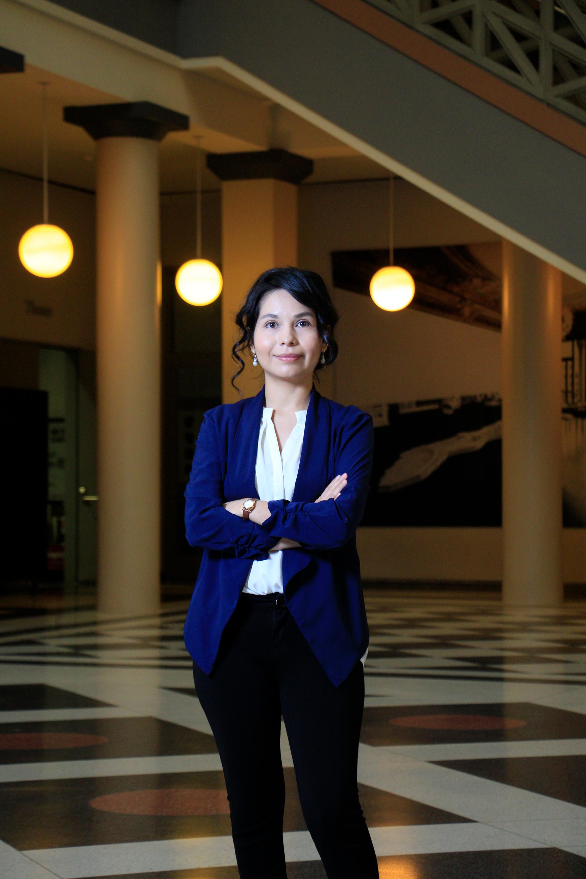 photo of Edith Villasenor standing in Atrium of Architecture building