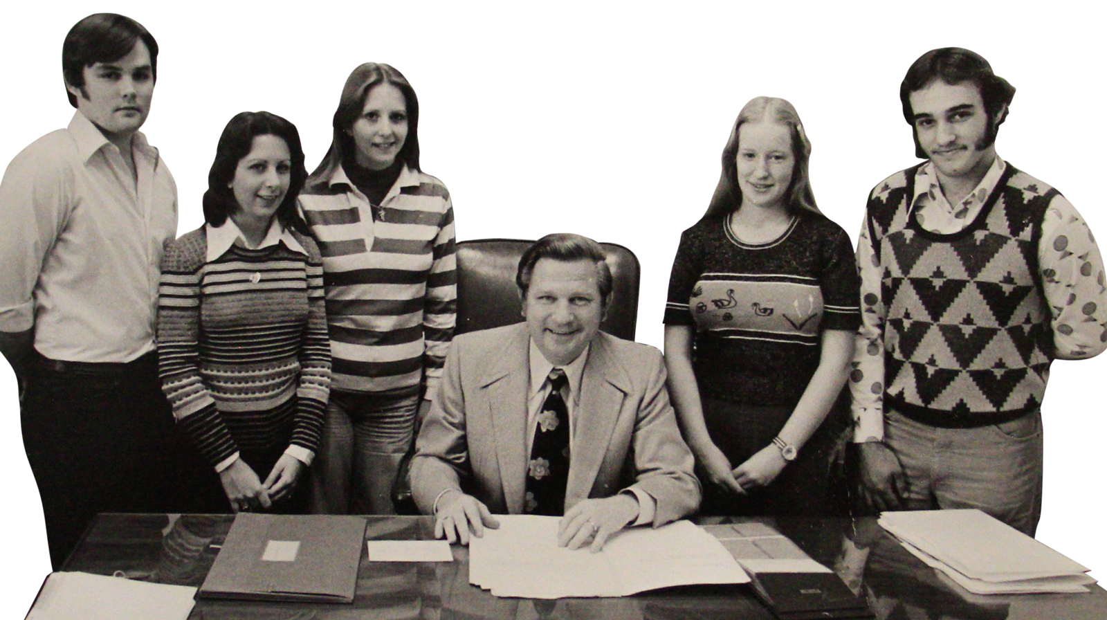 photo of a young Nancy Sims as a political staffer standing with a group of colleagues