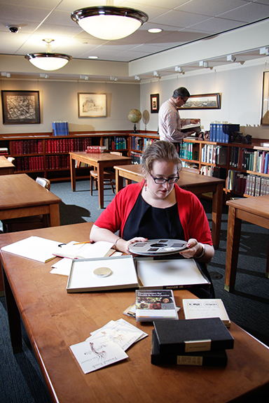 two researchers in the Special Collections reading room