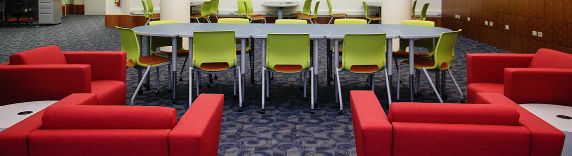 meeting table and comfy chairs in the new Digital Research Commons