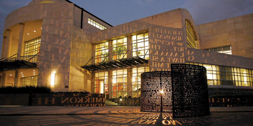 Exterior photo of MD Anderson Library at night