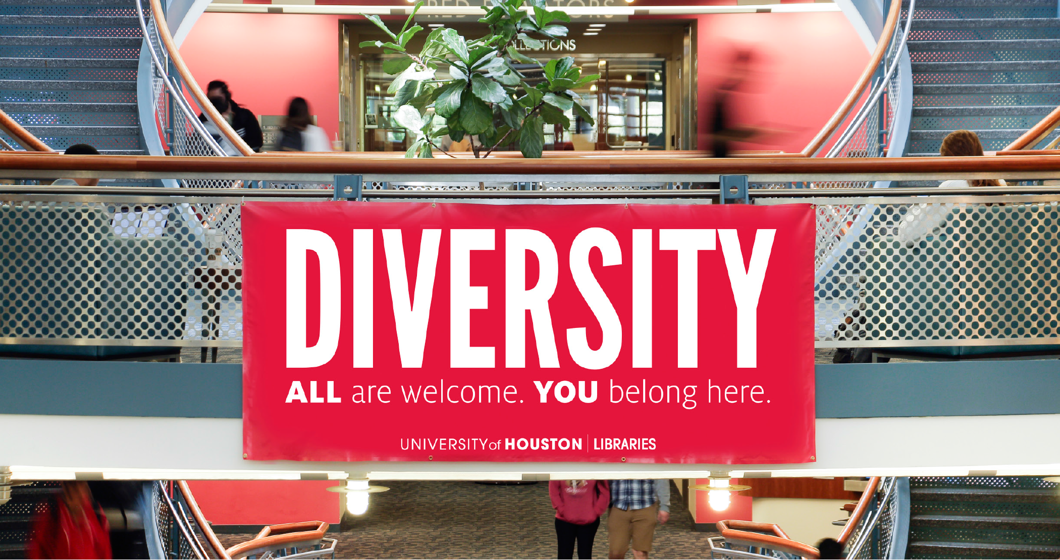 Diversity banner hanging from the second floor balcony in the MD Anderson Library