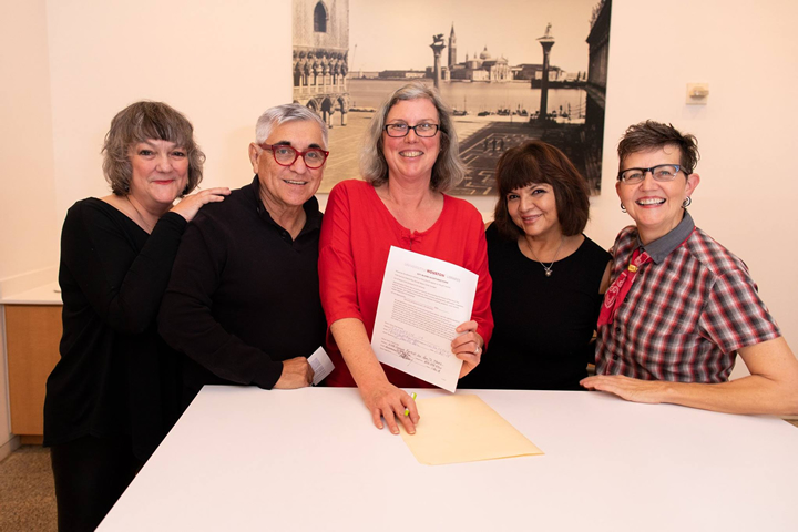 "The official gift signing for the Mydolls archive at a Museum of Fine Arts, Houston screening of ""Paris, Texas"" (1984), a film in which Mydolls appeared. From left: Linda Younger, George Reyes, curator Mary Manning, Trish Herrera, Dianna Ray. Photo credit: F. Carter Smith."