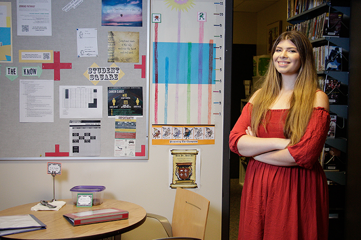 Vocal Performance graduate student Kate DeYoung stands near the student assistants' space in the UH Music Library.